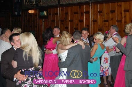 guests-joining-in-with-the-bride-and-groom-for-the-first-dance-in-worsley-court-house